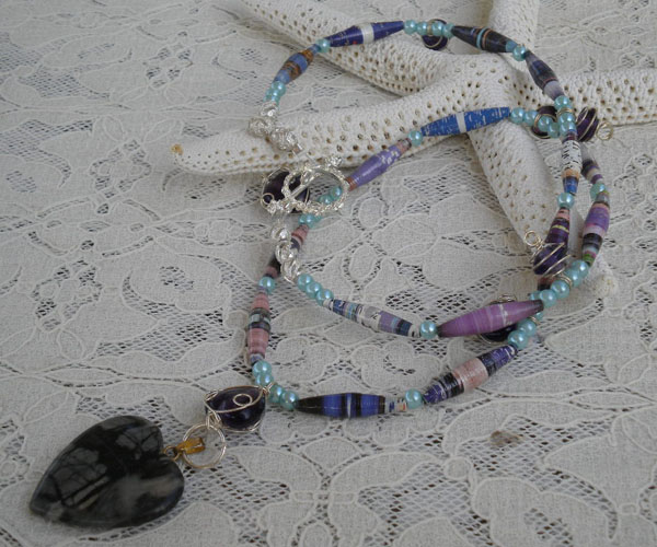 A long necklace using tube shaped paper beads (aubreysbeads.com)