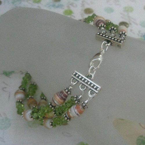 a Three strand paper bead bracelet