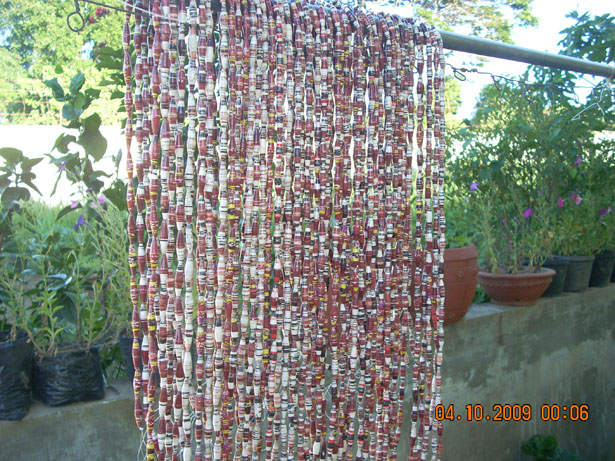 Strand of paper beads hanging to dry