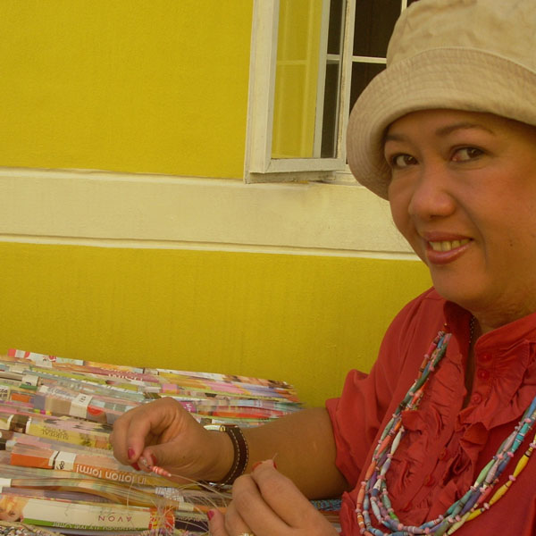 Joann designs the shapes and sizes of the finished paper beads