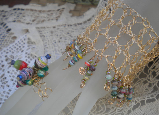 Crocheted wire bracelet with paper bead charms
