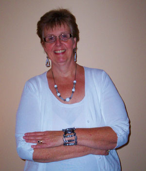 Kathy wearing her big and bold paper bead jewelry